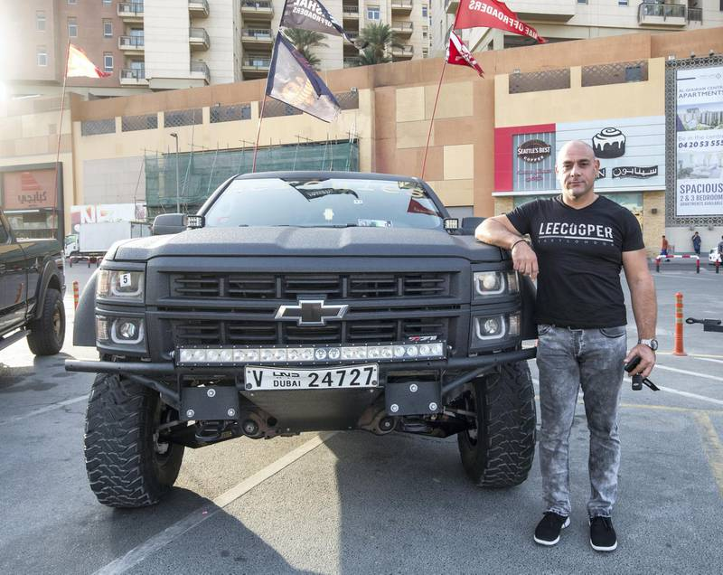 DUBAI, UNITED ARAB EMIRATES -Fadi, owner of Chevy Hercules model 2014 with modified body texture and fully modified with bajakits King of the Trucks winner at UAE Offroaders Show at Al Ghurair Centre.  Leslie Pableo for The National for Adam Workman's story