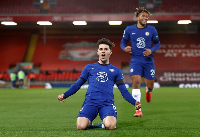 LIVERPOOL, ENGLAND - MARCH 04: Mason Mount of Chelsea celebrates after scoring his team's first goal during the Premier League match between Liverpool and Chelsea at Anfield on March 04, 2021 in Liverpool, England. Sporting stadiums around the UK remain under strict restrictions due to the Coronavirus Pandemic as Government social distancing laws prohibit fans inside venues resulting in games being played behind closed doors. (Photo by Phil Noble - Pool/Getty Images)