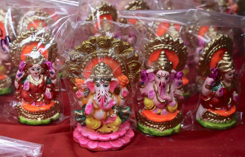 DUBAI, UNITED ARAB EMIRATES , November 1 – 2020 :- Colourful Indian idols for Diwali festival on display at the shop in Bur Dubai in Dubai. Diwali is the Indian festival of lights and this year it will be on 14th November. (Pawan Singh / The National) For News/Standalone/Online/Instagram/Big Picture
