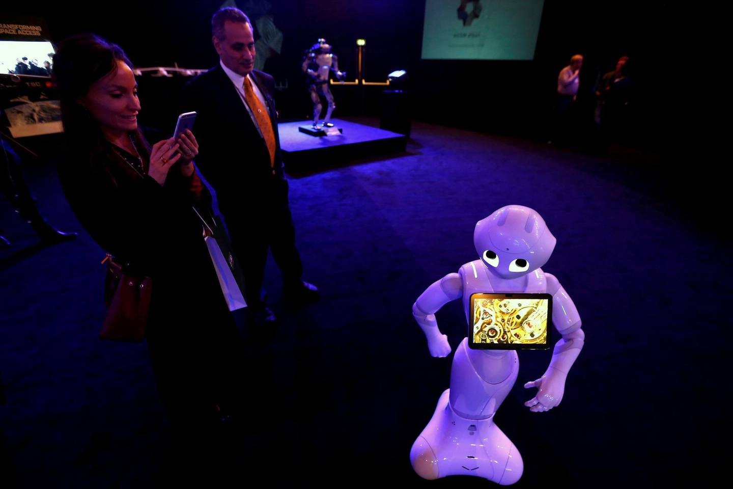 FILE PHOTO: A visitor takes pictures of a robot during an exhibition on 'Neom', a new business and industrial city, in Riyadh, Saudi Arabia, October 25, 2017. REUTERS/Faisal Al Nasser/File Photo
