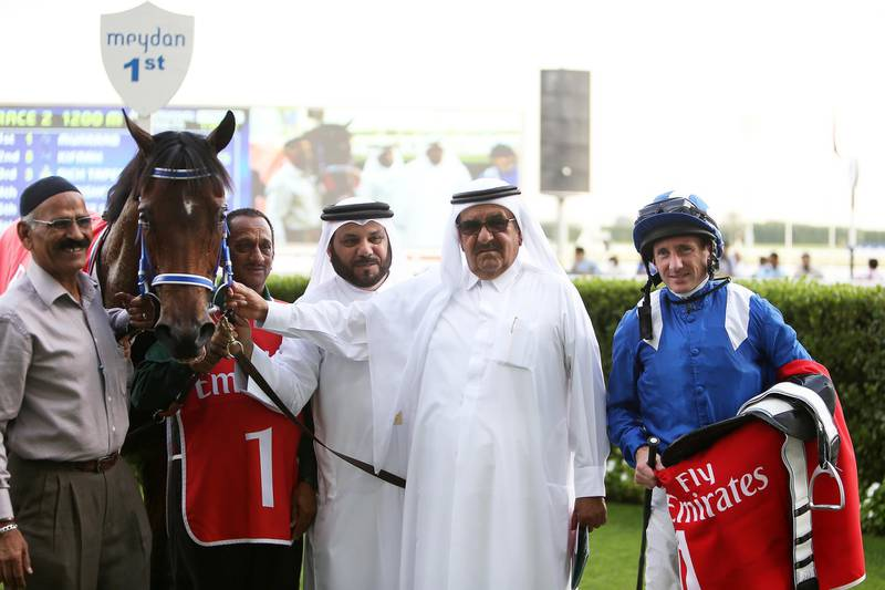 DUBAI , UNITED ARAB EMIRATES – March 5 , 2016 : Muarrab ( GB ) number ( 1 )  ridden by Paul Hanagan won the 2nd horse race 1200m ( Dirt ) at the Meydan Racecourse in Dubai. H . H . Sheikh Hamdan Bin Rashid Al Maktoum ( center ) is also seen in the photo.  ( Pawan Singh / The National ) For Sports. Story by Geoffrey Riddle. ID No : 95593  *** Local Caption ***  PS0503- HORSE RACE15.jpg
