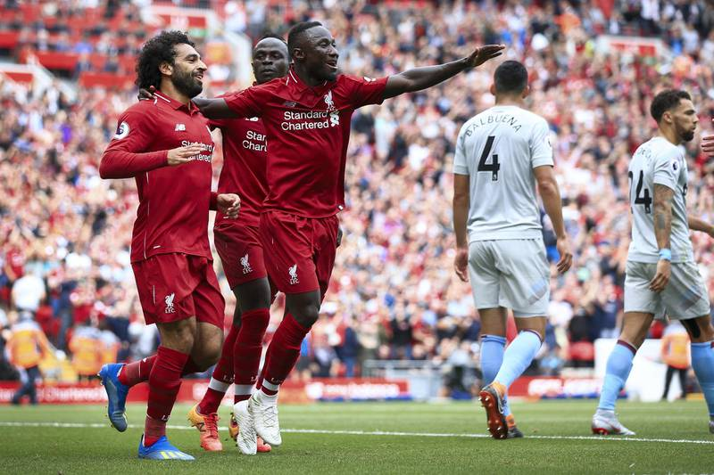LIVERPOOL, ENGLAND - AUGUST 12: Mohamed Salah of Liverpool (L) celebrates with Naby Keita of Liverpool (R) and Sadio Mane of Liverpool (C) after scoring their 1st goal during the Premier League match between Liverpool and West Ham United at Anfield on August 12, 2018 in Liverpool, England. (Photo by Simon Stacpoole/Offside/Getty Images)