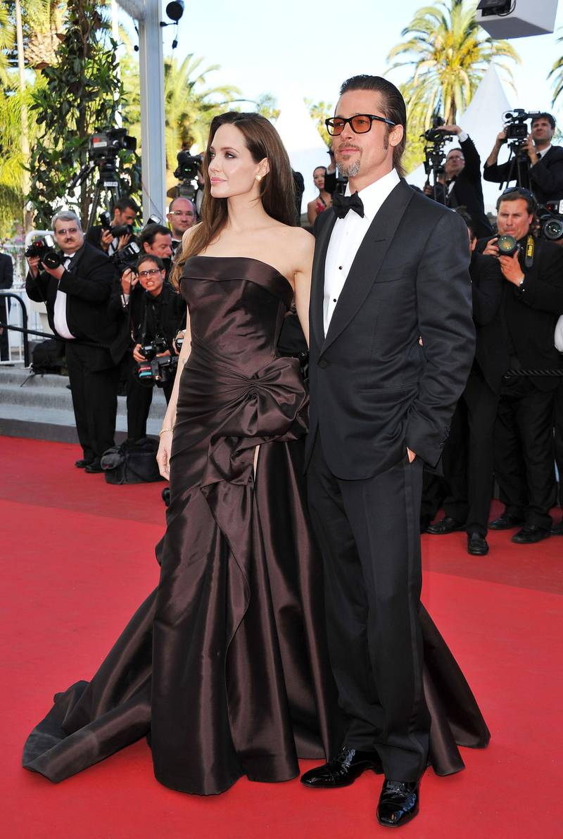"""CANNES, FRANCE - MAY 16:  Angelina Jolie (L) and Brad Pitt attend """"The Tree Of Life"""" premiere during the 64th Annual Cannes Film Festival at Palais des Festivals on May 16, 2011 in Cannes, France.  (Photo by Pascal Le Segretain/Getty Images)"""