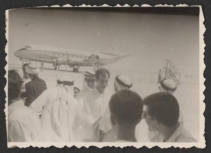 A reception for Rashid bin Saeed Al Maktoum during the grand opening of the Dubai Airport with an Iran Air plane in the background, 1960. Copyright Abdulghafoor Al Qasim