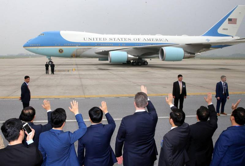 epa07403462 Officials (front) wave at Air Force One as US President Donald J. Trump leaves from Nom Bar International Airport in Hanoi, Vietnam, 28 February 2019, after the second US-North Korea Summit. US President Trump and North Korean leader Kim abruptly ended their second summit on 28 February, with no agreement.  EPA/STRINGER -- VIETNAM OUT --  EDITORIAL USE ONLY