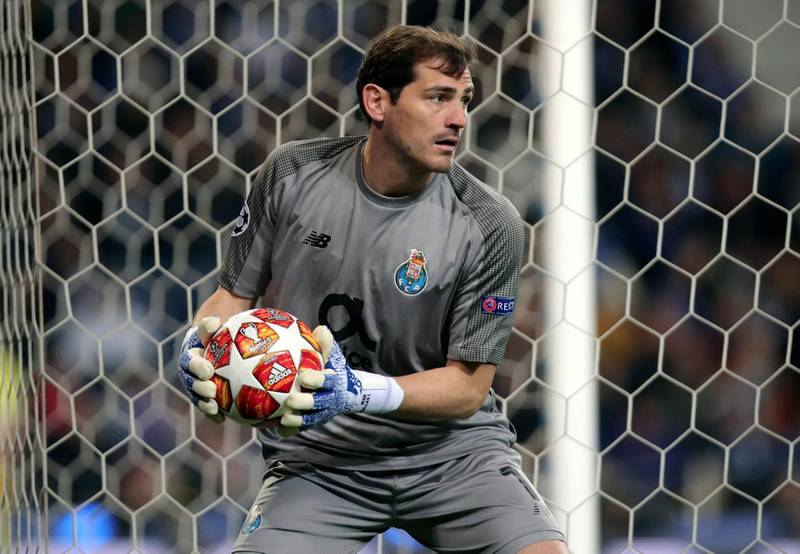 """FILE - In this Wednesday, April 17, 2019 file photo, Porto goalkeeper Iker Casillas holds the ball during their Champions League quarterfinals, 2nd leg, soccer match against Liverpool at the Dragao stadium in Porto, Portugal. Veteran goalkeeper Iker Casillas has had a heart attack but is out of danger, Porto said Wednesday, May 1. The Portuguese club said Casillas fell ill during a practice session and remains hospitalized, but the """"heart condition has been resolved.""""  (AP Photo/Luis Vieira, file)"""