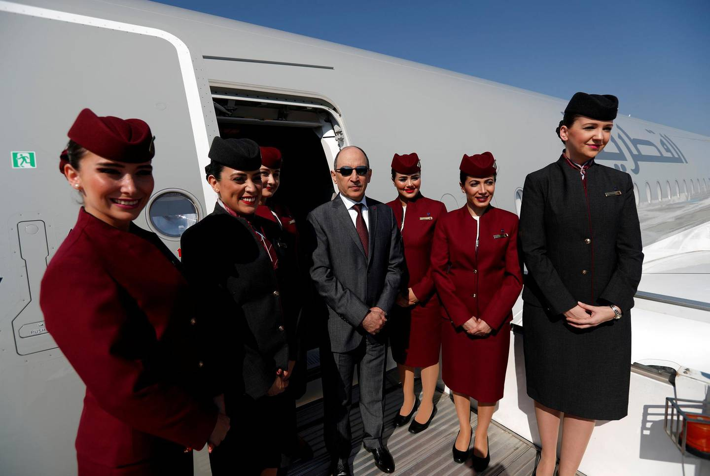 FILE PHOTO: Qatar Airways Chief Executive Officer Akbar al-Baker poses with cabin crew in an Airbus A350-1000 at the Eurasia Airshow in the Mediterranean resort city of Antalya, Turkey April 25, 2018. REUTERS/Murad Sezer/File Photo