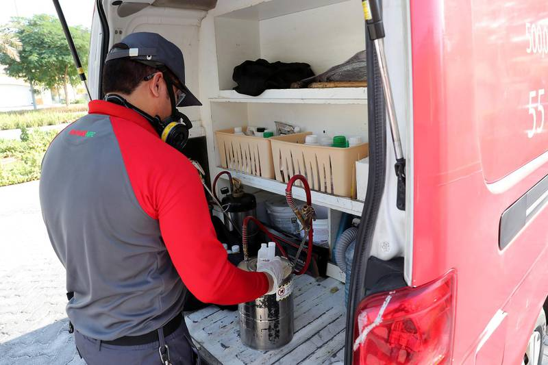 DUBAI, UNITED ARAB EMIRATES , November 10 – 2020 :- John Well, Technician with Rentokil Pest Control company mixing the chemical spray for the pest control treatment for crazy ants at the villa in Jumeirah Park in Dubai. (Pawan Singh / The National) For News/Online. Story by Kelly