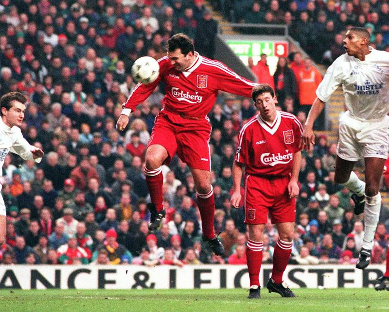 Liverpool's Neil Ruddock rises above his team-mate Robbie Fowler to head his side's opening goal in their defeat of Leeds at Anfield today (Saturday).   (Photo by PA Images via Getty Images)