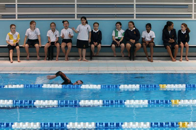 DUBAI , UNITED ARAB EMIRATES Ð Jan 23 : Students of grade five watching Edward Hawkins , teacher of Geography and History during the swimming at the Repton school in Dubai. ( Pawan Singh / The National ) For News. Story by Eugene Harnan