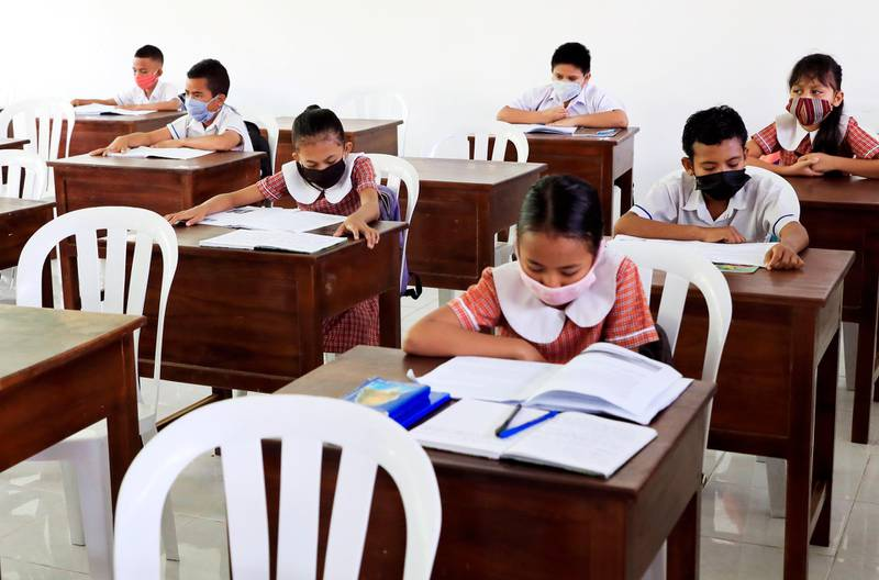 epa08515448 Students wearing protective face masks during a class at a reopened school amid an easing of coronavirus restrictions in Dili, Timor Leste, also known as East Timor, 29 June 2020. The government reopened some qualified schools with cover-19 protocol.  EPA/ANTONIO DASIPARU