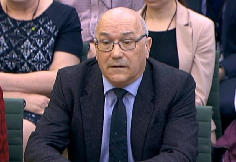 In this image taken from video, Mark Goldring, CEO of Oxfam GB, gives evidence before the Commons Development Committee at Portcullis House, London, Tuesday Feb. 20, 2018. British lawmakers are set to question officials of two anti-poverty charities Tuesday amid concern sex predators are targeting aid organizations because of the chaotic environments in which they work. (PA via AP)