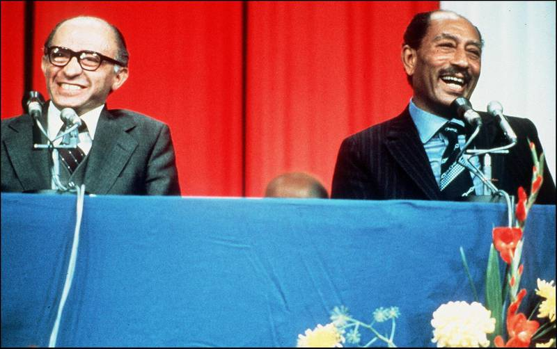 """Photo taken on 20 November 1977 of Egyptian President Anwar Sadat (R) during a joint press conference he gave with Israeli Prime Minister Menachem Begin during his historic visit to Israel. - His widow Jihane said in an interview broadcast on Israeli television on 19 November that her husband """"knew he was going to die, but that did not change his mind in his peace endeavor"""". Anwar al-Sadat's visit to Israel led fifteen months later to the signing of the first peace treaty between Israel and an Arab country. In October 1981, Sadat was assassinated in Cairo by Islamists. (Photo by - / AFP)"""