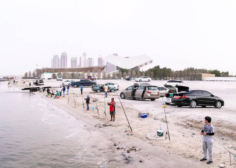 DUBAI, UNITED ARAB EMIRATES. 28 JULY 2020. People fishing by Business Bay Bridge.(Photo: Reem Mohammed/The National)Reporter:Section: