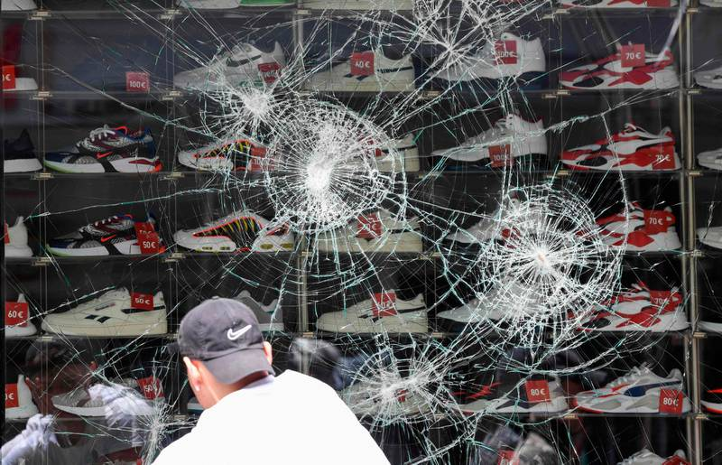 A broken shop window of a shoe store is pictured in Stuttgart, southern Germany on June 21, 2020. Hundreds of people ran riot in Stuttgart's city centre in the early hours of Sunday, June 21, 2020, throwing stones and bottles at police and plundering stores after smashing shop windows. / AFP / THOMAS KIENZLE