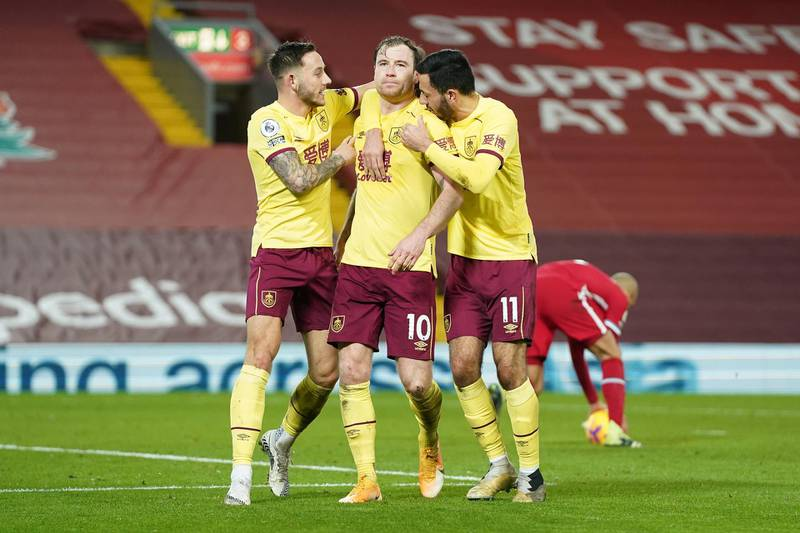 LIVERPOOL, ENGLAND - JANUARY 21: Ashley Barnes of Burnley celebrates with team mates (L - R) Josh Brownhill and Dwight McNeil after scoring their side's first goal during the Premier League match between Liverpool and Burnley at Anfield on January 21, 2021 in Liverpool, England. Sporting stadiums around the UK remain under strict restrictions due to the Coronavirus Pandemic as Government social distancing laws prohibit fans inside venues resulting in games being played behind closed doors. (Photo by Jon Super - Pool/Getty Images)