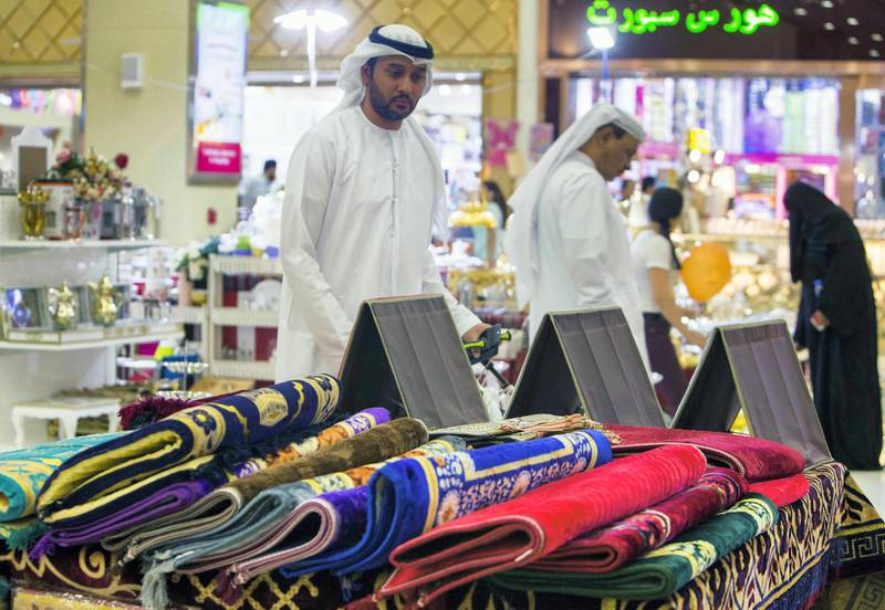 DUBAI, UNITED ARAB EMIRATES, 04 May 2018 - Local shoppers checking out Ramadan related items at Ramadan Market that opens May 3 till 19 at  Dragon Mart 2.  Leslie Pableo for The National for Ellen Fortini's story