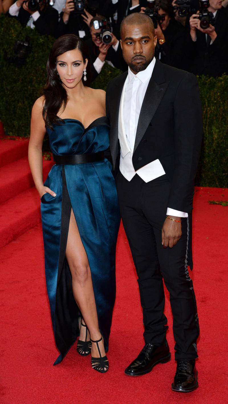 epa04192888 US socialite Kim Kardashian (L) and US singer Kanye West (R) arrive for the 2014 Anna Wintour Costume Center Gala held at the New York Metropolitan Museum of Art in New York, New York, USA, 05 May 2014. The Costume Institute's new Anna Wintour Costume Center opens on 08 May with the exhibition 'Charles James: Beyond Fashion.'  EPA/JUSTIN LANE
