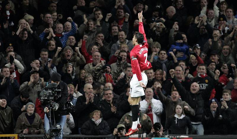 Manchester United's Portugese midfielder Cristiano Ronaldo of Portugal celebrates scoring against Bolton Wanderers during their English Premier League football match at Old Trafford in manchester, north west England, March 19, 2008. AFP PHOTO/PAUL ELLIS  - (Photo by PAUL ELLIS / AFP)