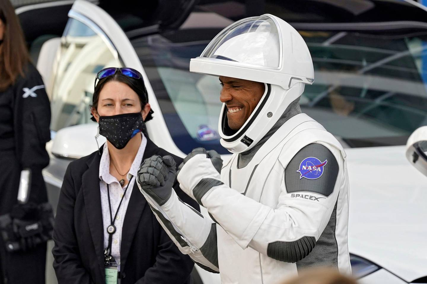 NASA astronaut Victor Glover reacts to family members as leaves the Operations and Checkout Building with fellow crew members for a trip to Launch Pad 39-A and planned liftoff on a SpaceX Falcon 9 rocket with the Crew Dragon capsule on a six-month mission to the International Space Station Sunday, Nov. 15, 2020, at the Kennedy Space Center in Cape Canaveral, Fla. (AP Photo/John Raoux)