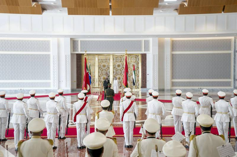 ABU DHABI, UNITED ARAB EMIRATES - July 13, 2018: HH Sheikh Mohamed bin Zayed Al Nahyan Crown Prince of Abu Dhabi Deputy Supreme Commander of the UAE Armed Forces (center R) and HE Cyril Ramaphosa, President of South Africa (center L), stand for the UAE national anthem during a reception at the Presidential Airport.  ( Rashed Al Mansoori / Crown Prince Court - Abu Dhabi ) ---