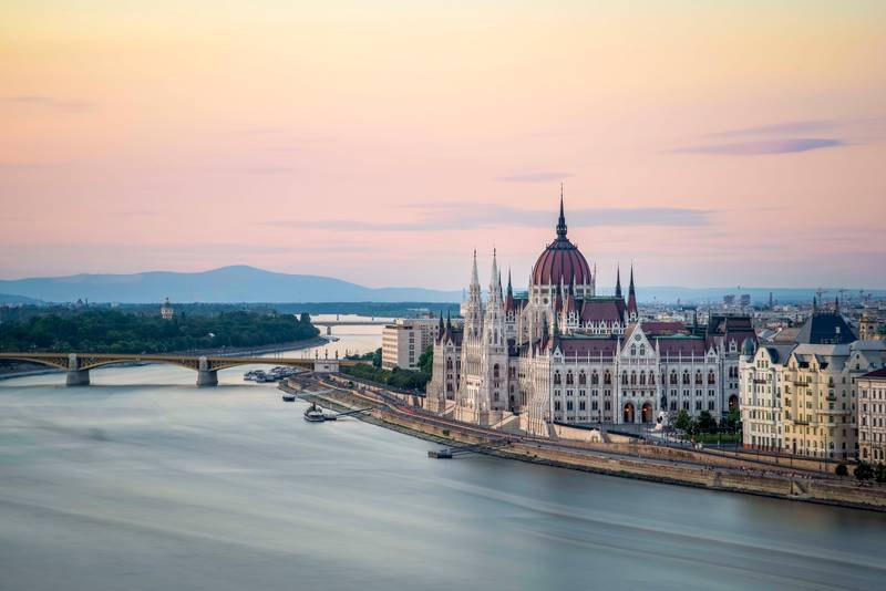 The Hungarian Parliament Building on the Banks of the Danube at dawn. Getty Images