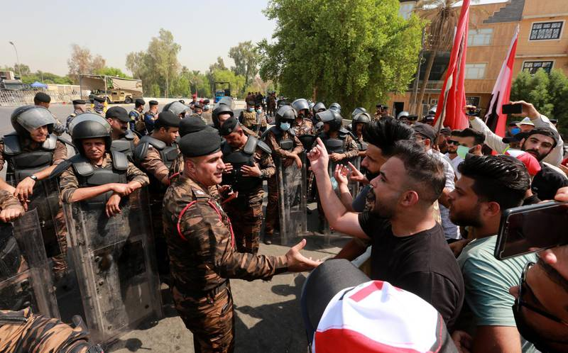 epa08656671 Jobless graduates speak with Iraqi police officers as Iraqi riot police forces take position during a demonstration near the heavily fortified Green Zone which houses the Iraqi government offices in central Baghdad, Iraq, 09 September 2020. Thousands of university graduates and jobless people continue their protests in Baghdad outside government ministries demanding jobs, while the Iraqi government admits it has not planned for the large numbers of students coming into the job market every year.  EPA-EFE/AHMED JALIL *** Local Caption *** 56329544