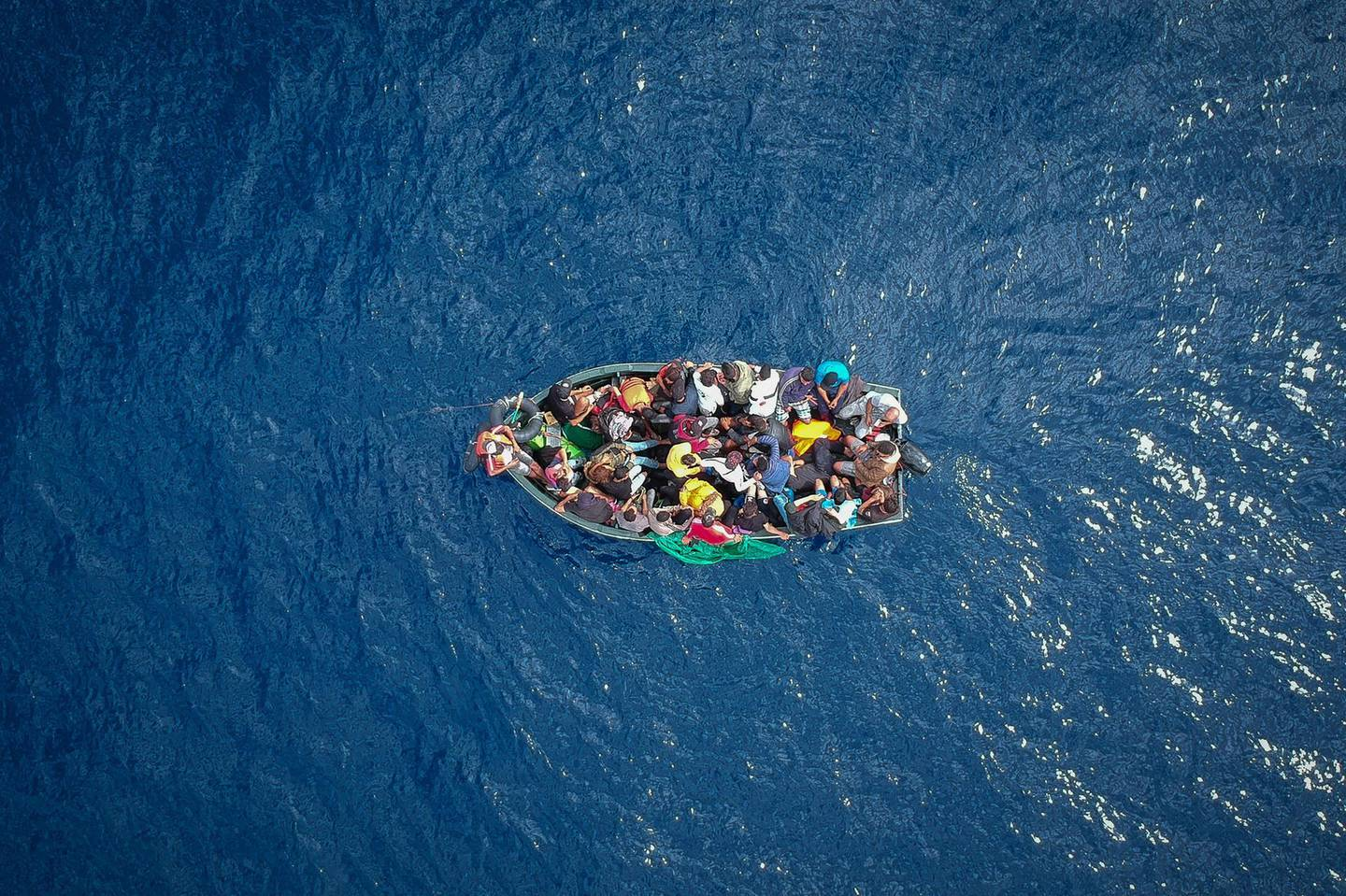 An aerial photo shows a boat carrying migrants stranded in the Strait of Gibraltar before being rescued by the Spanish Guardia Civil and the Salvamento Maritimo sea search and rescue agency that saw 157 migrants rescued on September 8, 2018. - While the overall number of migrants reaching Europe by sea is down from a peak in 2015, Spain has seen a steady increase in arrivals this year and has overtaken Italy as the preferred destination for people desperate to reach the continent. Over 33,000 migrants have arrived in Spain by sea and land so far this year, and 329 have died in the attempt, according to the International Organization for Migration. (Photo by Marcos Moreno / AFP)