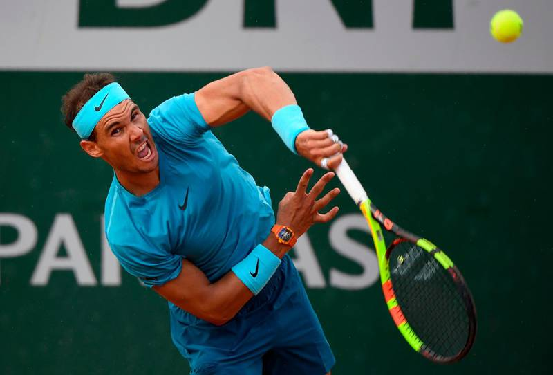 TOPSHOT - Spain's Rafael Nadal serves to Argentina's Guido Pella during their men's singles second round match on day five of The Roland Garros 2018 French Open tennis tournament in Paris on May 31, 2018.  / AFP / Eric FEFERBERG