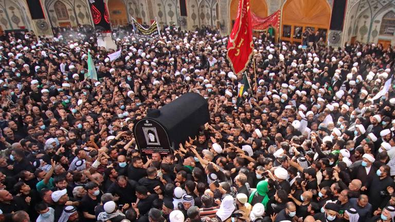 An image that illustrates this article Iraq's Shiite cleric Mohammed Saeed Al Hakim buried in Najaf