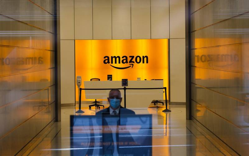 epa08873753 (FILE) A man is seen inside the entrance to the Amazon offices in New York, New York, USA, on 27 May 2020 (reissued 10 December 2020). According to media reports on 10 December 2020, French data privacy regulator CNIL will impose over 100 million euros fines on US companies Google and Amazon for breaching EU privacy data rules. According to media reports, Google will have to pay 100 million euros and Amazon 35 million euros fines.  EPA/HAYOUNG JEON *** Local Caption *** 56200286