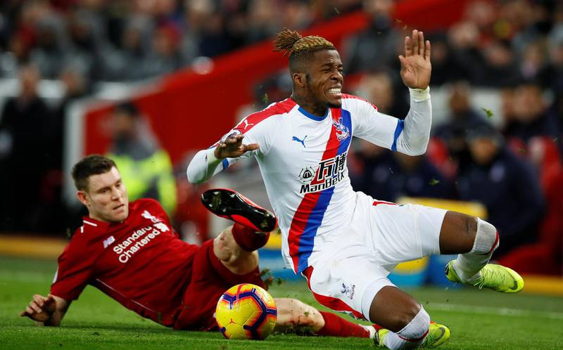"""Soccer Football - Premier League - Liverpool v Crystal Palace - Anfield, Liverpool, Britain - January 19, 2019  Crystal Palace's Wilfried Zaha in action with Liverpool's James Milner   Action Images via Reuters/Jason Cairnduff  EDITORIAL USE ONLY. No use with unauthorized audio, video, data, fixture lists, club/league logos or """"live"""" services. Online in-match use limited to 75 images, no video emulation. No use in betting, games or single club/league/player publications.  Please contact your account representative for further details."""