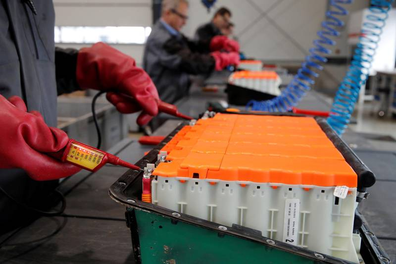 REFILE-CLARIFYING CAPTION The remaining voltage of a used Lithium-ion car battery is checked before its dismantling by an employee of the German recycling firm Accurec in Krefeld, Germany, November 16, 2017. Picture taken November 16, 2017.   REUTERS/Wolfgang Rattay
