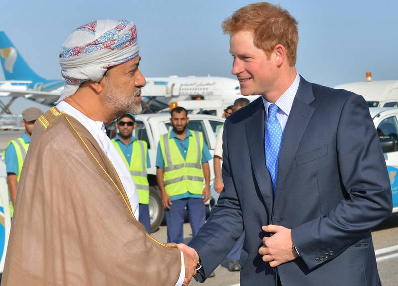 """A handout image made available by Oman News Agency (ONA) shows Britain's Prince Harry being welcomed by Omani Minister of Culture and Heritage Sayyid Haitham Bin Tariq Al Said, upon his arrival in Oman, on November 18 2014. AFP PHOTO/HO/ONA == RESTRICTED TO EDITORIAL USE - MANDATORY CREDIT """"AFP PHOTO/HO/OMAN NEWS AGENCY (ONA)"""" NO MARKETING NO ADVERTISING CAMPAIGNS - DISTRIBUTED AS A SERVICE TO CLIENTS== (Photo by - / ONA / AFP)"""