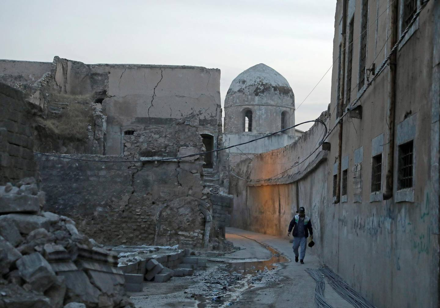 A man walks near the Church of Saint Thomas, in the Old City of Mosul, Iraq October 28, 2020. Picture taken October 28, 2020. REUTERS/Abdullah Rashid
