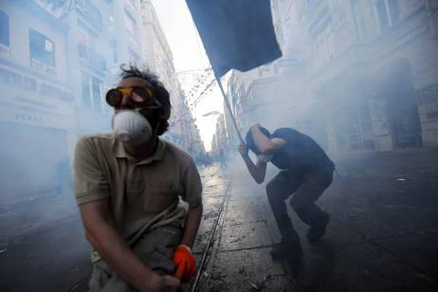 Protestors clash with Turkish riot policemen during a protest against the demolition of Taksim Gezi Park on May 31, 2013, in Taksim quarter of Istanbul. Police reportedly used tear gas on early May 31 to disperse a group, who were standing guard in Gezi Parki to prevent the Istanbul metropolitan municipality from demolishing the last remaining green public space in the center of Istanbul as a part of a major  renewal project of Taksim. AFP PHOTO/BULENT KILIC