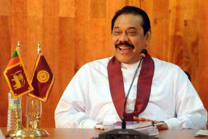 Sri Lankan President Mahinda Rajapakse chairs the weekly cabinet meeting held at a military base in northern Kilinochchi district on July 14, 2010. The military base adjoins the Iranamadu water reservoir that was once used by the now defeated Tamil Tiger rebels when they ruled one-third of the island. The rebels were defeated last May in a military onslaught which wiped off the Tigers top leadership and ended the guerrillas 37-year struggle for a separate homeland for minority Tamils from the majority Sinhalese community. AFP PHOTO/Ishara S.KODIKARA.