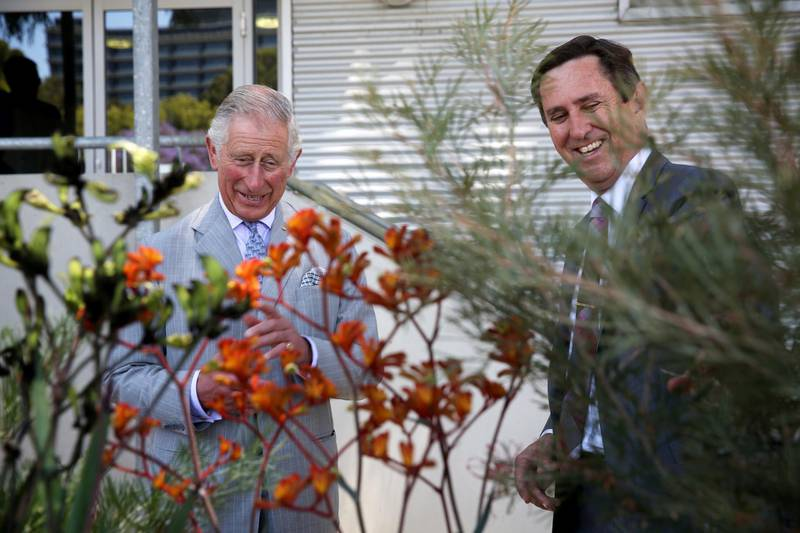 Britain's Prince Charles talks with Chief Executive Officer of the Botanic Gardens and Parks Authority, Mark Webb during a visit to the Biodiversity Conservation Centre in Perth on November 15, 2015. The Royal couple are on a 12-day tour visiting seven regions in New Zealand and three states and one territory in Australia. AFP PHOTO / POOL / Richard Wainwright (Photo by RICHARD WAINWRIGHT / POOL / AFP)