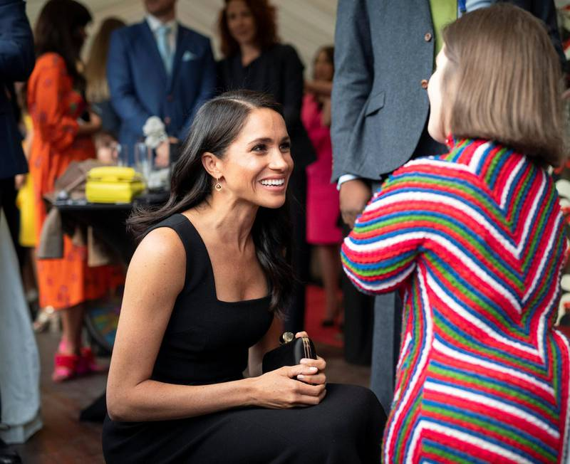 DUBLIN, IRELAND - JULY 10: Meghan, Duchess of Sussex chats with Sinead Burke, writer and advocate of fashion and disability rights during  a reception at Glencairn, the residence of Robin Barnett, the British Ambassador to Ireland during day one of their visit to Ireland on July 10, 2018 in Dublin, Ireland. (Photo by Geoff Pugh - WPA Pool/Getty Images)
