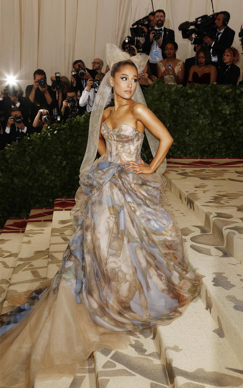 """epa06717974 Arianna Grande arrives on the red carpet for the Metropolitan Museum of Art Costume Institute's benefit celebrating the opening of the exhibit """"Heavenly Bodies: Fashion and the Catholic Imagination"""" in New York, New York, USA, 07 May 2018. The exhibit will be on view at the Metropolitan Museum of Art's Costume Institute from 10 May to 08 October 2018.  EPA-EFE/JUSTIN LANE"""