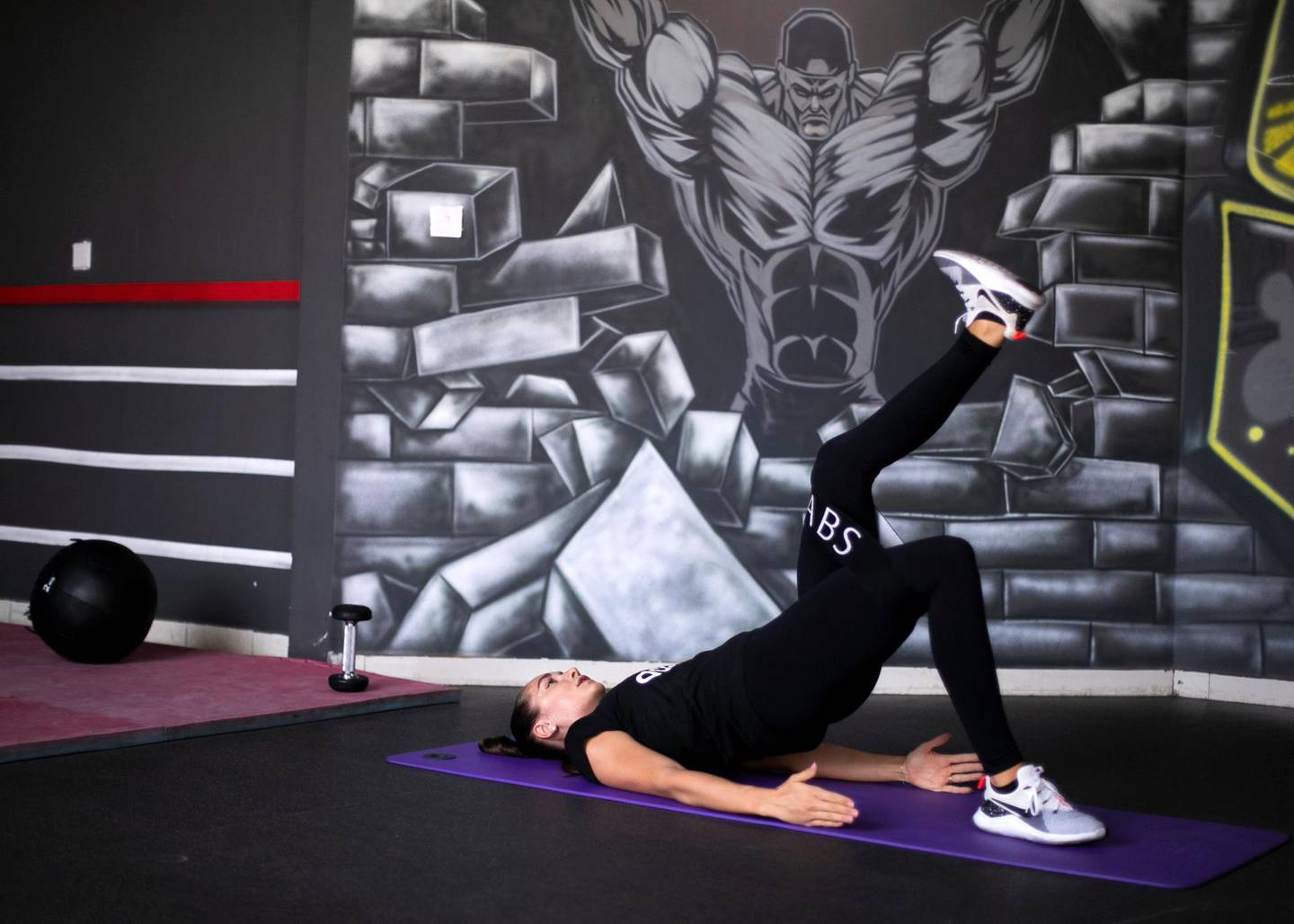 DUBAI, UNITED ARAB EMIRATES. 19 AUGUST 2019. Personal trainer, Olga Martinica, demostrates a single leg glute with a resistance band, an excercise part of the pre-natal and post-partum fitness at Super Boost Gym Al Barsha.(Photo: Reem Mohammed/The National)Reporter: HAFSA LODISection: LF
