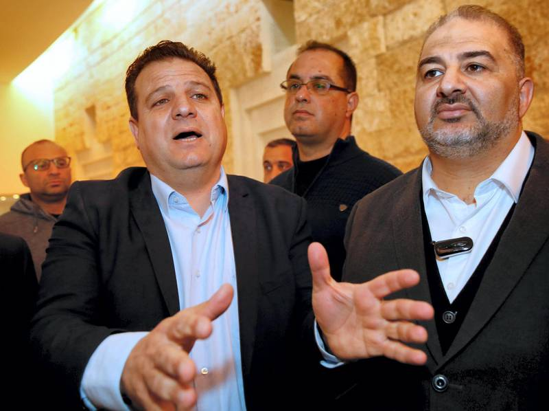 Arab Israeli Knesset Member Ayman Odeh (L) speaks to the press as he stands next to the  head of the Arab Israeli Islamic Party's southern branch, Abbas Mansur, after a hearing at the Israeli Supreme Court in Jerusalem on March 14, 2019, ahead of the upcoming general elections next month. - Arab parties represent the descendants of Palestinians who remained on their land when Israel was created in 1948 and constitute nearly a fifth of the country's population. The Joint List has separated and now Hadash, the communist party headed by Ayman Odeh, is running with Ahmed Tibi's Taal. Nationalistic group Balad joined forces with Raam, which represents the southern branch of the Islamic Movement. (Photo by GIL COHEN-MAGEN / AFP)