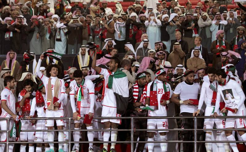 United Arab Emirates team celebrate at the end of their match against Iraq in the Gulf Cup final Friday, Jan. 18 , 2013, in Rifa, Bahrain. United Arab Emirates beat Iraq 2-1 in extra time on Friday to claim its second Gulf Cup title. (AP Photo/Hasan Jamali) *** Local Caption ***  Bahrain Gulf Cup.JPEG-07232.jpg