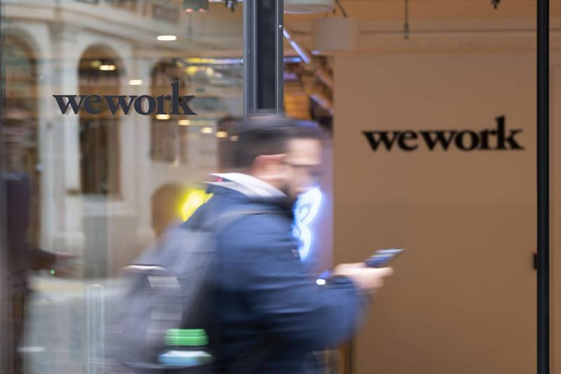 A pedestrian walks past the entrance to the We Work co-working office space, operated by the parent company We Co., on Eastcheap in London, U.K., on Monday, Oct. 7, 2019. While WeWork has been rapidly expanding in Canada, the New York-based company is facing challenges on multiple fronts with Landlords in London and New York the most exposed to any further deterioration at the co-working firm. Photographer: Bryn Colton/Bloomberg