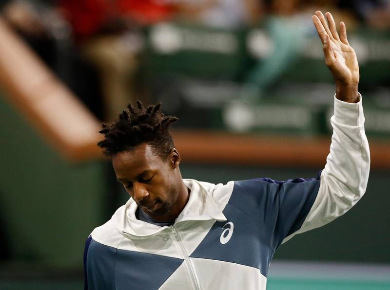 epa07438040 Gael Monfils of France waves to the crowd after he announces he has to withdraw due to an injury before his match against Dominic Thiem of Austria during the BNP Paribas Open tennis tournament at the Indian Wells Tennis Garden in Indian Wells, California, USA, 14 March 2019.  EPA/LARRY W. SMITH