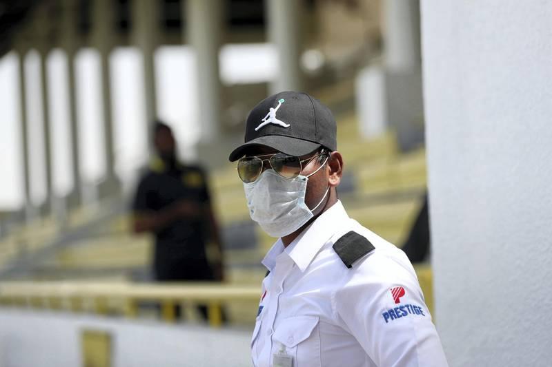 Dubai, United Arab Emirates - Reporter: Amith Passela: Security wear face masks on race day at Jebel Ali. Friday, March 20th, 2020. Jebel Ali Racecourse, Dubai. Chris Whiteoak / The National