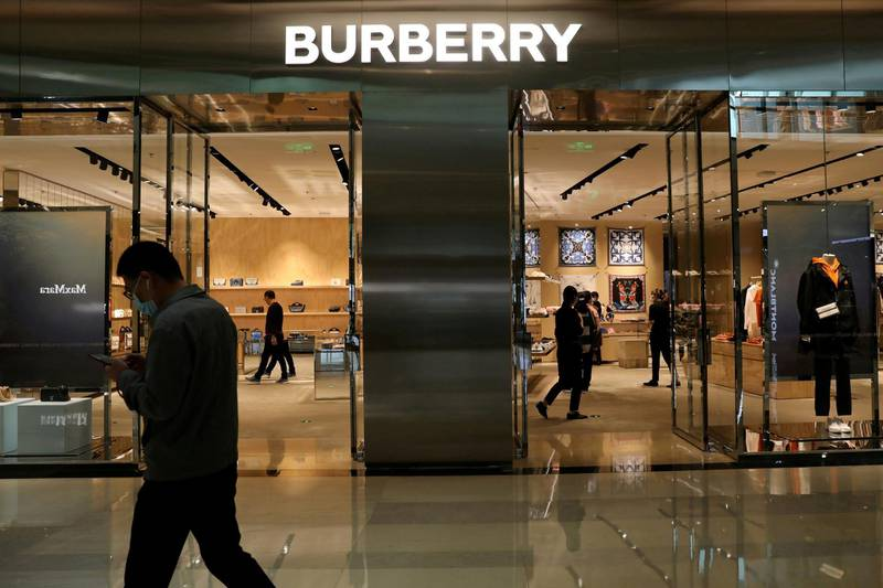 FILE PHOTO: A man walks past a store of luxury brand Burberry at a shopping mall in Beijing, China March 26, 2021. REUTERS/Tingshu Wang/File Photo