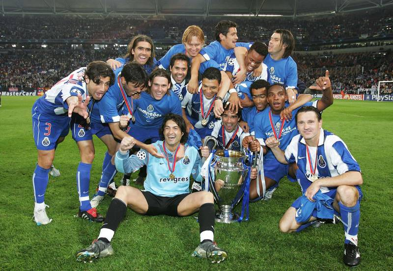 GELSENKIRCHEN, GERMANY - MAY 26:  FC Porto players celebrate winning the Champions League during the UEFA Champions League Final match between AS Monaco and FC Porto at the AufSchake Arena on May 26, 2004 in Gelsenkirchen, Germany.  (Photo by Shaun Botterill/Getty Images)