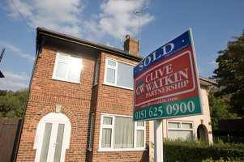 An estate agent's sign advertises a sold property on display outside a house in West Kirby, U.K., on Friday, Sept. 18, 2009. U.K. home sellers raised asking prices in September as confidence in the property market improved and the supply of homes dwindled, Rightmove Plc said. Photographer: Colin McPherson/Bloomberg