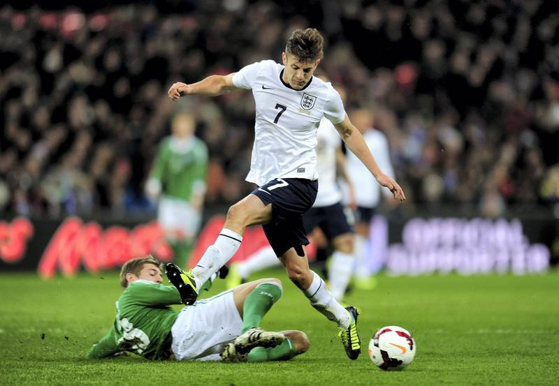 LONDON, ENGLAND - NOVEMBER 19:  Adam Lallana of England is tackled by Toni Kroos of Germany  during the international friendly match between England and Germany at Wembley Stadium on November 19, 2013 in London, England.  (Photo by Shaun Botterill/Getty Images)
